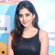 Nabha Natesh Latest Hot HD Photos in Black Sleeveless Dress